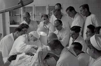 A photograph of surgeons in an operating theatre
